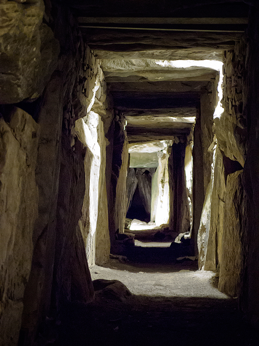 Knowth tomb: the weight of the mound have almost closed the stone passage already